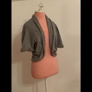 Grey shrug
